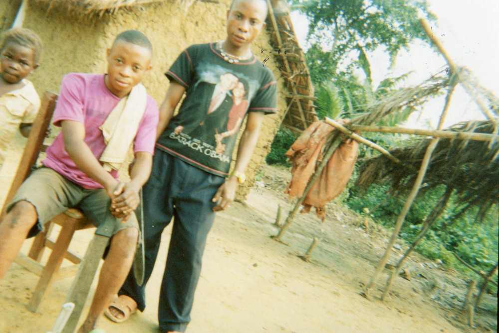 These young boys are my brothers who have machetes for farm activities.