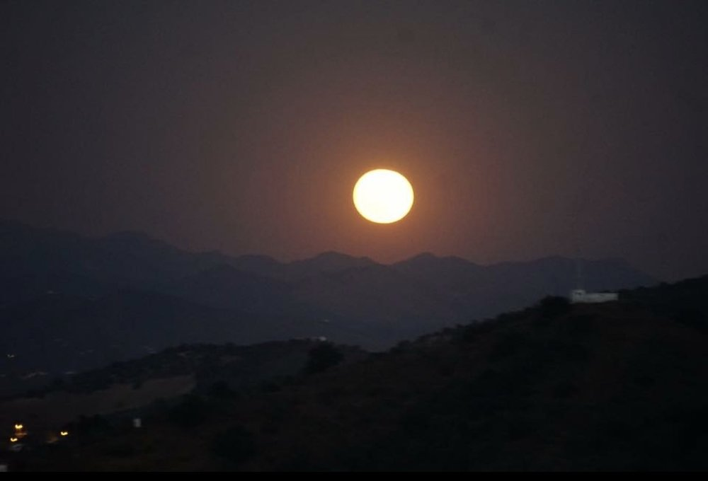 watch the moon rise out of the mountains while you have dinner!