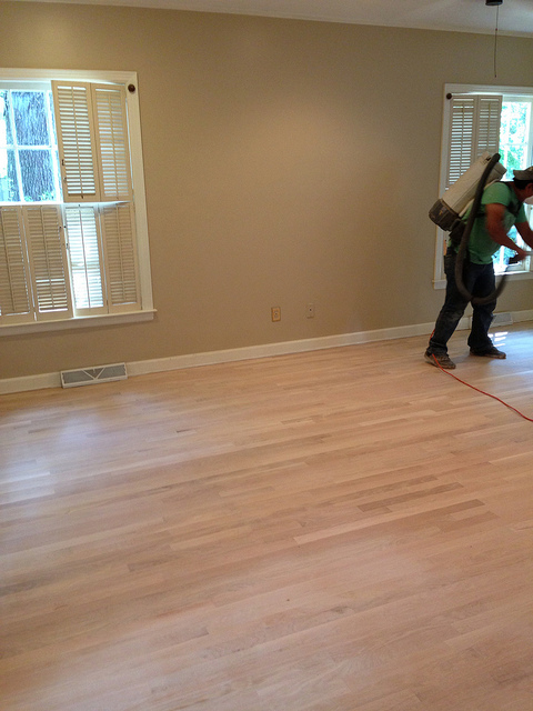 This is the master bedroom after they had sanded the floors to remove stains and damage.