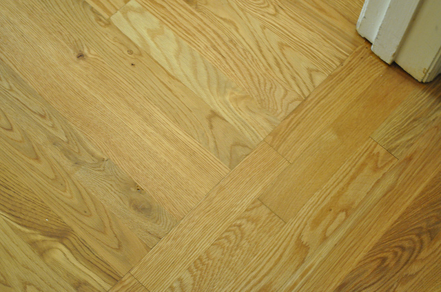 This is where the new wood in the guest room meets the original, refinished wood in the hallway. Such a perfect match even before the stain.