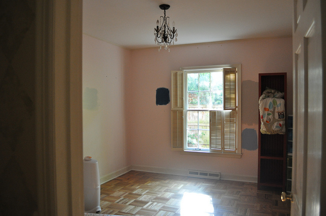 This is E's room with its pink walls and now amazing floors. I put several swatches on the wall, but didn't choose any of them.