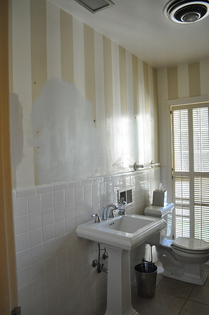 The front bathroom had stripes, which I didn't hate in theory. But, again with the dingy whites and cream.