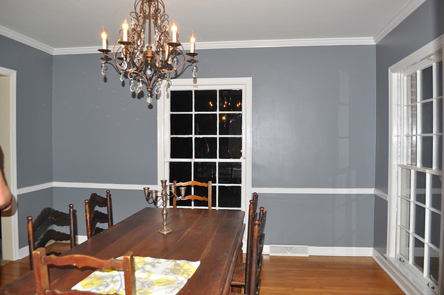 It's in the same family with the bathroom color, and I think the smokey blue undertone is the best. It completely transforms this room, and I think it looks so great with our furniture. Even the chandelier that was already in there looks new.