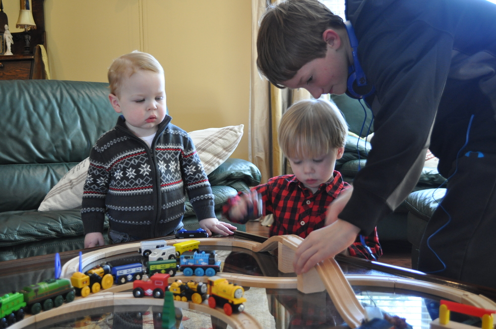 Bryce was patient with the little boys, and he helped them with the tracks.
