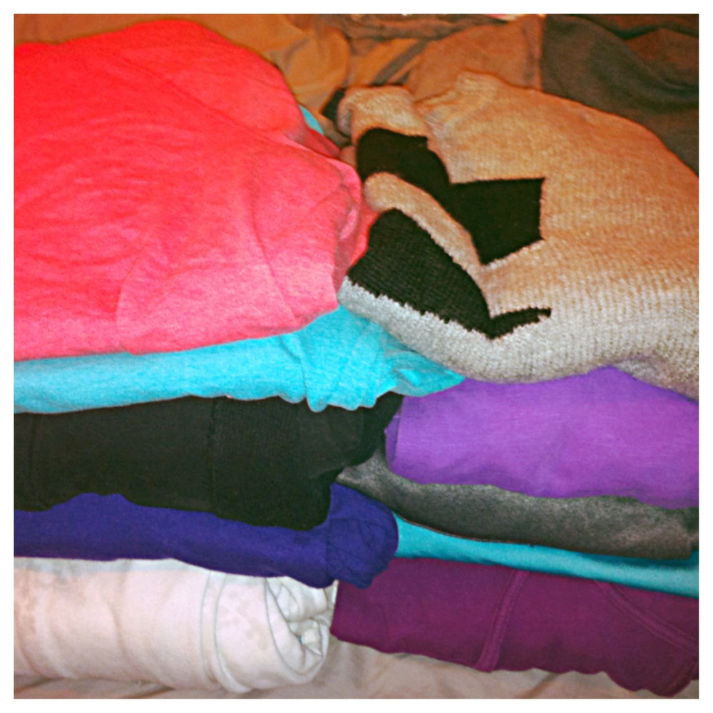 A few of the many sweaters I own all neatly folded.