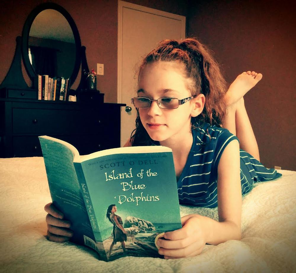 Teagan reading the 50th Anniversary Edition of the book.