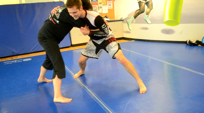 Jiu-Jitsu can begin standing, sitting, or even lying down. I prefer to start standing. This provides the added element of takedowns and throws.