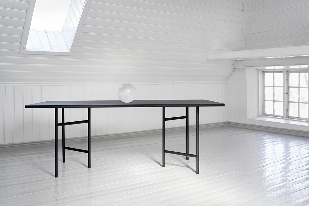 UN trestle base system by StokkeAustad for Elementa. The versatile trestle system can be used for a lot of different tabletops as well as shelving. Here shown as a conference table with a 200x90cm linoleum top.