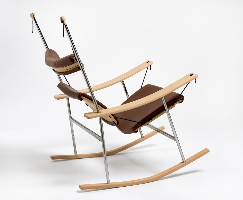 """This is a highly dynamic chair where both its curved rails (rocker) and its suspended support areas provide a sitting experience close to a floating sensation. As natural as your foot follows the rhythm in a melody, your feet will guide you when sitting in this chair. You find your rhythm automatically almost like a reflex."" . The Reflex3 chair was originally designed in 2009 for Norwegian startup Naturellement. Today it is manufactured by the German company HolzWerk"