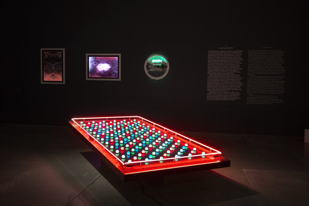 Iftikhar Dadi and Elizabeth Dadi's Magical Carpet II, 2005-2016, created through the use of laser print and coloured light bulbs gives the impression of levitation in the becoming of a digital age.