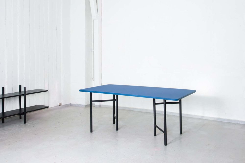 Un Divided Dining Table in blue Forbo Desktop Linoleum. Photo: Svein Gunnar Kjøde