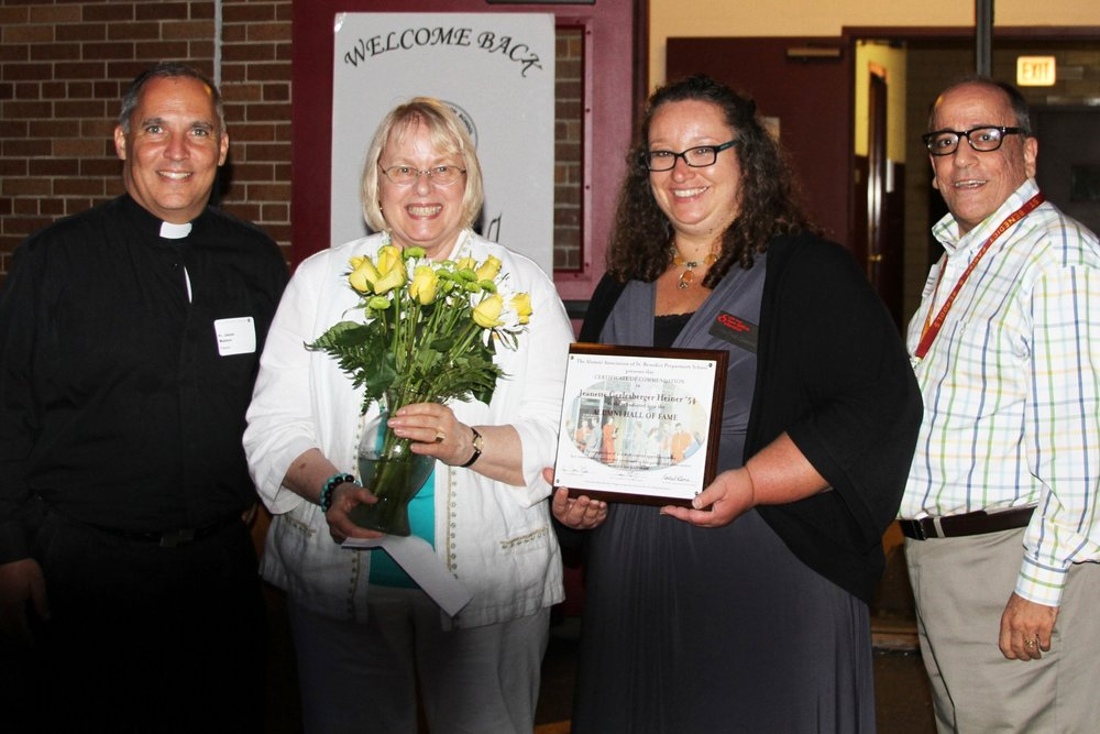 Jeannette Heiner '54 inducted into the alumni hall of fame in August of 2016 with Fr. Jason Malave, Ms. Rachel Gemo, and Mr. Ben Mazzone