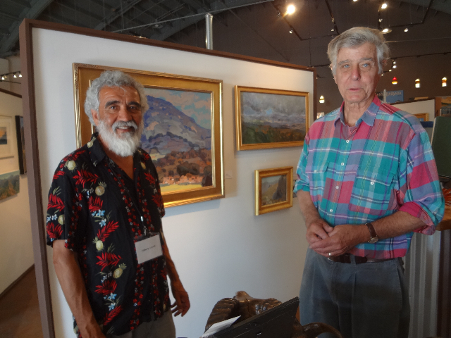 Artists/Scape Board members Filiberto Lomeli and Don Crocker at exhibit wall