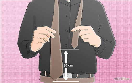 Put the tie around your neck . One end should be considerably wider than the other. Make sure the wider end is on the right, and about a foot (30cm) lower than the thinner side on the left.