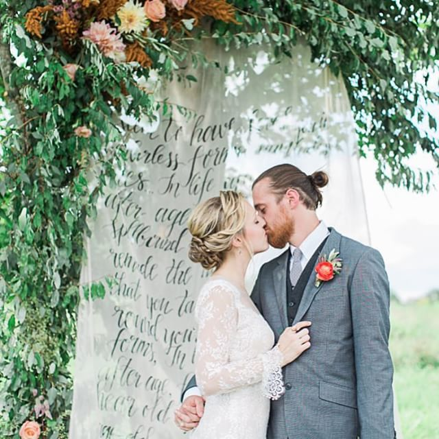So fun seeing sneak peeks of @laurenfair's A Love Affair: The Workshop popping up! This stunner was taken by the uber talented @sophiekawalek and features our sheer, hand lettered backdrop paired with @oleanderfloral's stunning floral garland installation. Hair & makeup by @truebeautymarks & dress from @lovelybride Philly #sandpiperandco #loveaffairtheworkshop