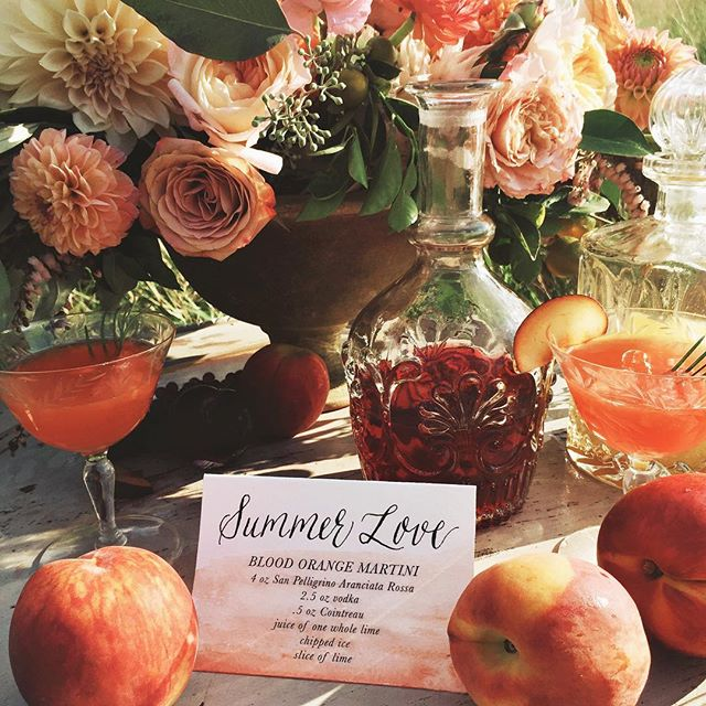 Happy Friday, ya'll! I think we all deserve one of these blood orange martinis, yeah?! 🍊  Our #sandpiperandco watercolored & hand lettered calligraphy cocktail sign for the #loveaffairtheworkshop shoot last week with @laurenfair & @oleanderfloral