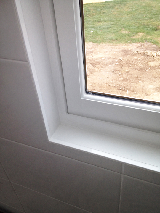 Clean finishing edge trim for tile wall at window
