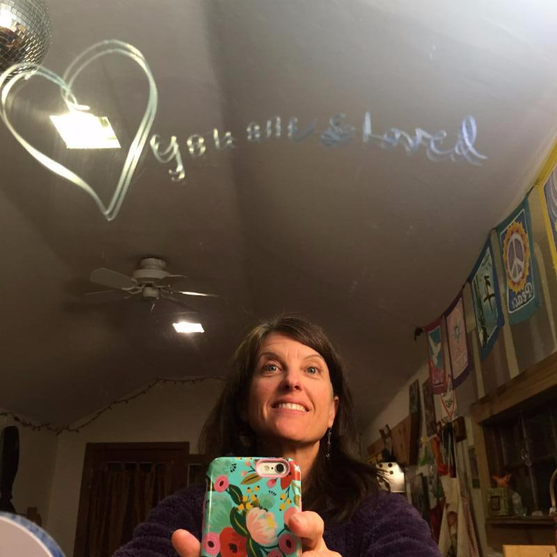 """In my studio I write notes to stay inspired. This one says """"you are loved""""."""