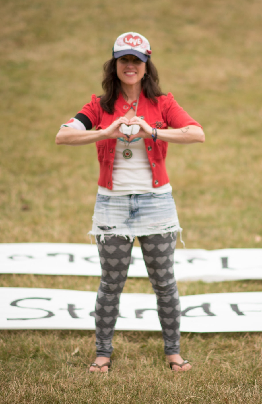 I stand For love Sarah with signs.jpg