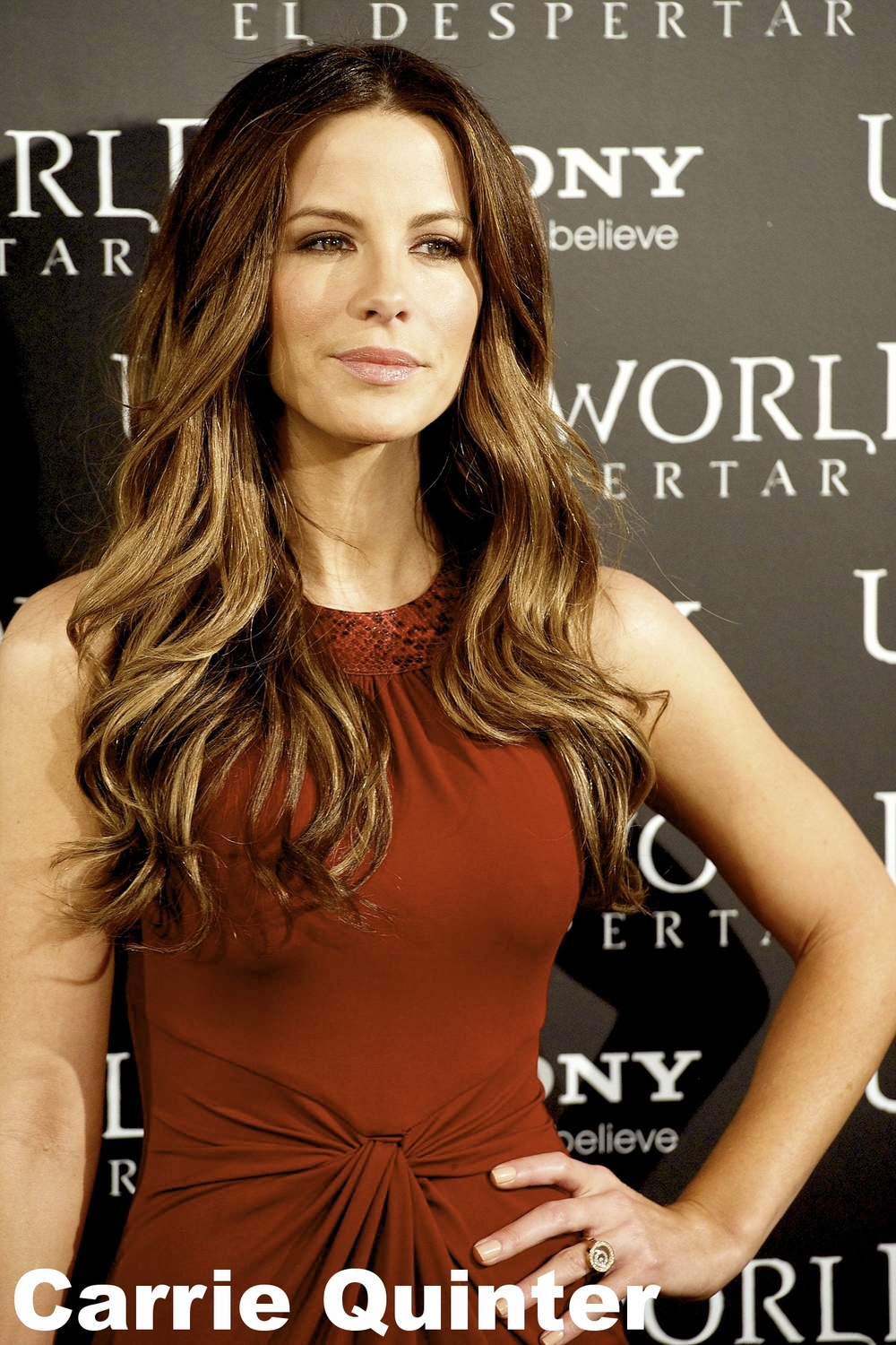 Kate Beckinsale Red Dress Candids at Photocall Underworld Awakening in Madrid-01.jpg
