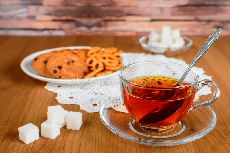 rich-tea-glass-cup-cookies-refined-sugar-lace-napkin-106892054.jpg