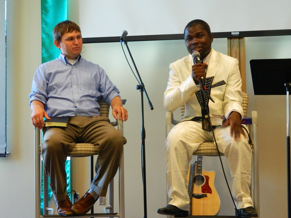 Pastor Samuel Gayetaye (right) converses with Pastor Rich during Sunday morning's worship service.