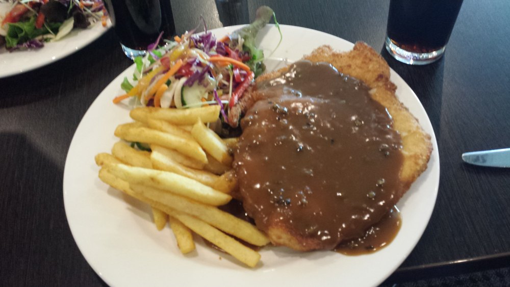 Chicken schnitzel with pepper sauce