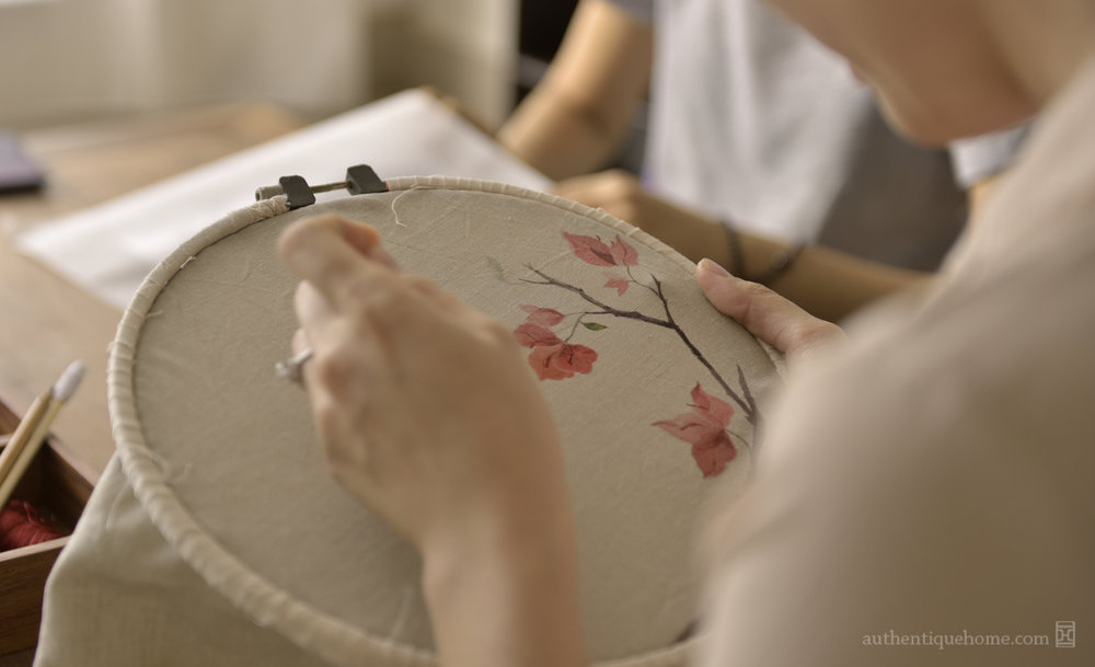 Once this inspiring process is finished, the painting is to be reproduced in ceramic and textile form, a process that is many times more demanding. In textile work, the choice of fabrics, colours, and techniques all influence the final product in meaningful ways, and are chosen based on the way they best and most beautifully represent the bougainvillea and all of its endearing characteristics. In this endeavour, our textile artisans have turned to drawing directly onto the fabric in order to depict the fragility of the petals, which is a great and very different challenge to drawing on paper.