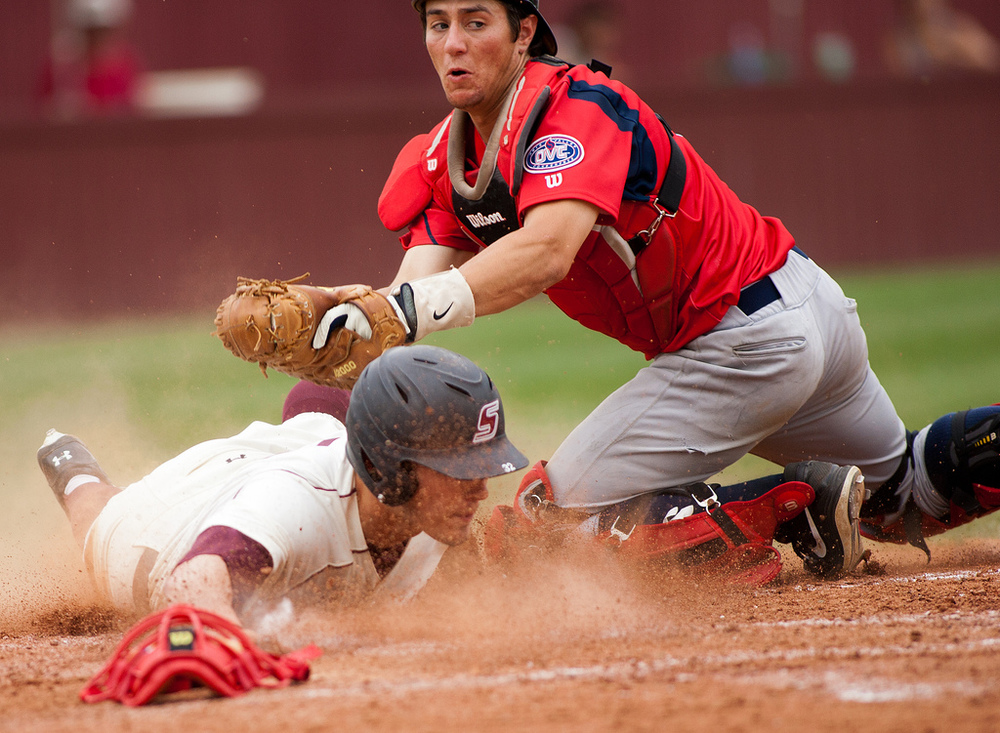 Belmont's Alec Diamond attempts to tag out Southern Illinois' Rennie Troggio at home plate on May 1, 2013 at Abe Martin Field in Carbondale, Ill. Southern Illinois won, 2-1.