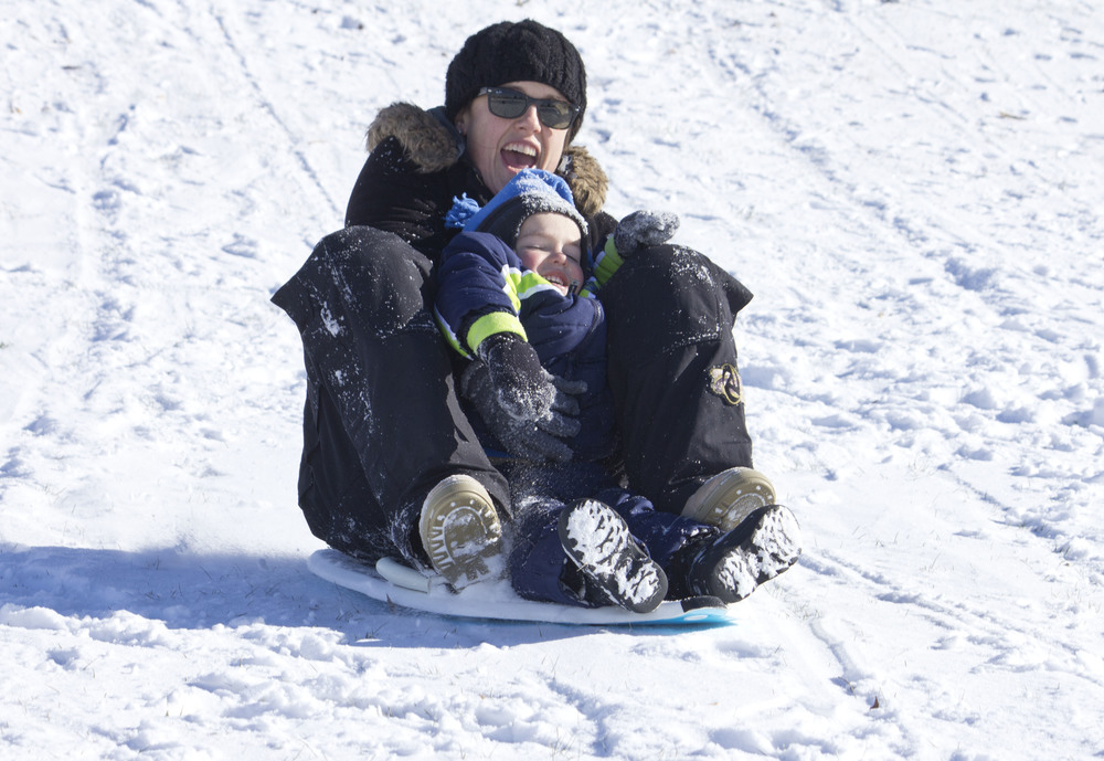 Jessica Pease, of Carbondale, sleds downhill with her son James, 2.