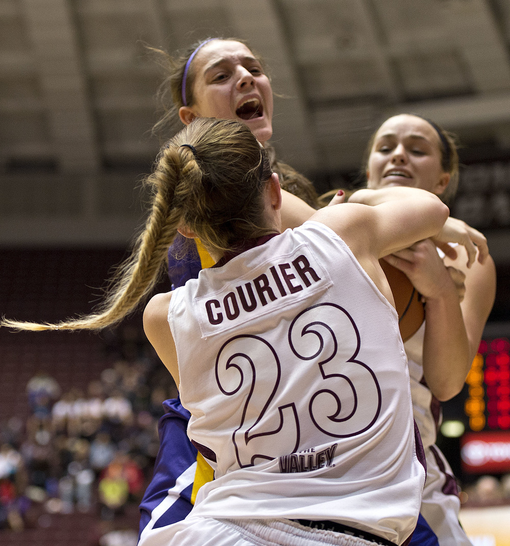 Saluki guards Jordyn Courier and Hannah Shores double team Northern Iowa guard Madison Weekly.
