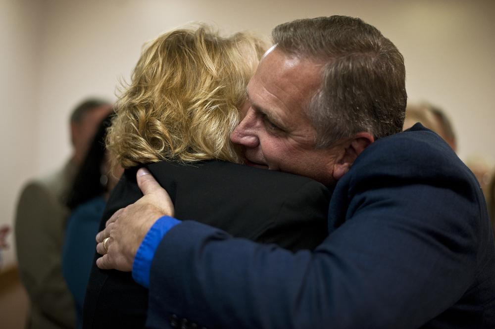 Mike Bost (R-Murphysboro) and Terri Bryant (R-Murphysboro) embrace.