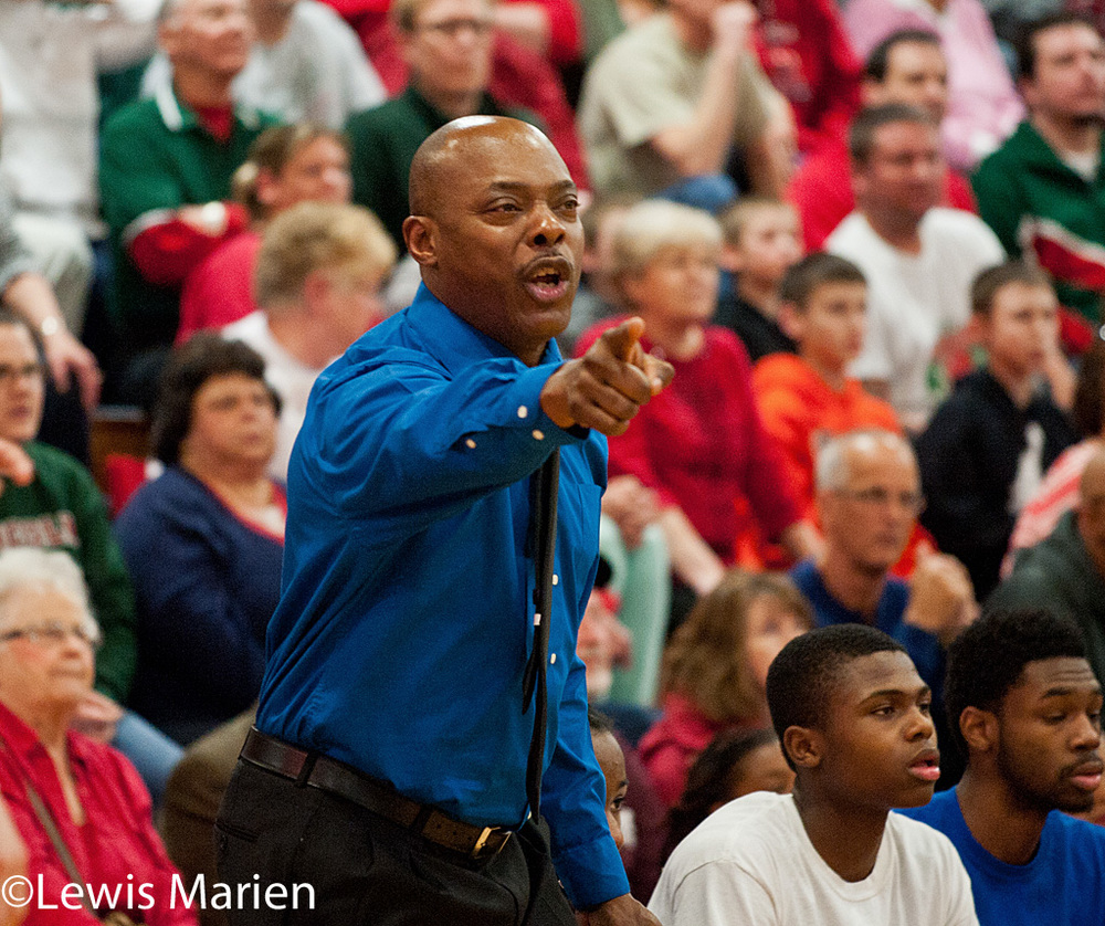 MacArthur head coach Ron Ingram calls out a play during the Generals' regional championship game with the Lincoln Railers at Mount Zion High School in Mount Zion, Ill. MacArthur won 57-38.