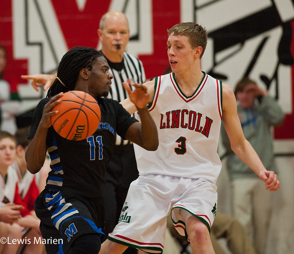 MacArthur's Shawntrez Spates (11) tries to get around Lincoln's Will Cook (3)  during the Generals' regional championship game with the Railers at Mount Zion High School in Mount Zion, Ill. MacArthur won 57-38.