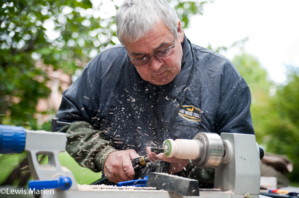 Jerry Rhoads, of Saint Joseph, Ill., makes a new spinning top during the Galesburg Civic Art Center's 29th annual Art in the Park on Sept. 12 at Standish Park in Galesburg, Ill.