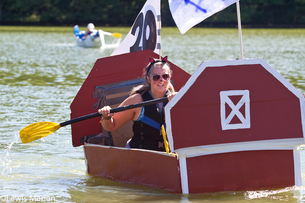"Cierra Hambsch, of Galesburg, Ill., nears the finish line with her team Galesburg FFA, or ""Flooded Farm Animals"", during the 22nd annual Great Cardboard Boat Regatta on Sept. 13 at Lake Storey in Galesburg, Ill."