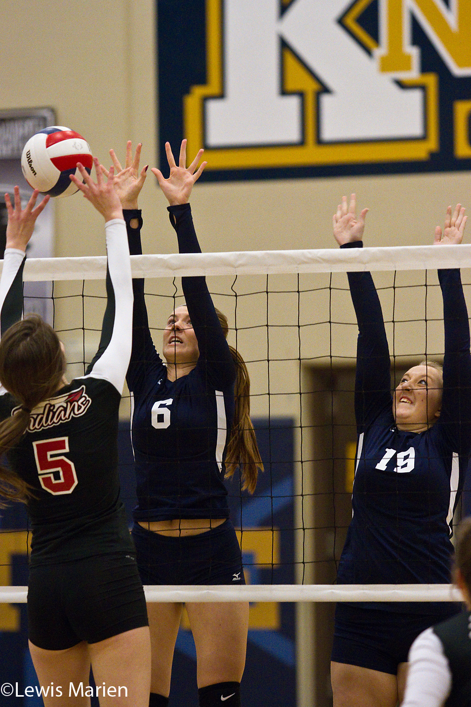 Knoxville's Chloe Palmer (6) and Nicole Lehman (19) defend a shot from Brimfield-Elmwood's Alannah Chaney (5) during the game Sept. 28 at Knoxville High School in Knoxville, Ill. The Blue Bullets lost to the Indians in two sets, 25-15 and 25-22.