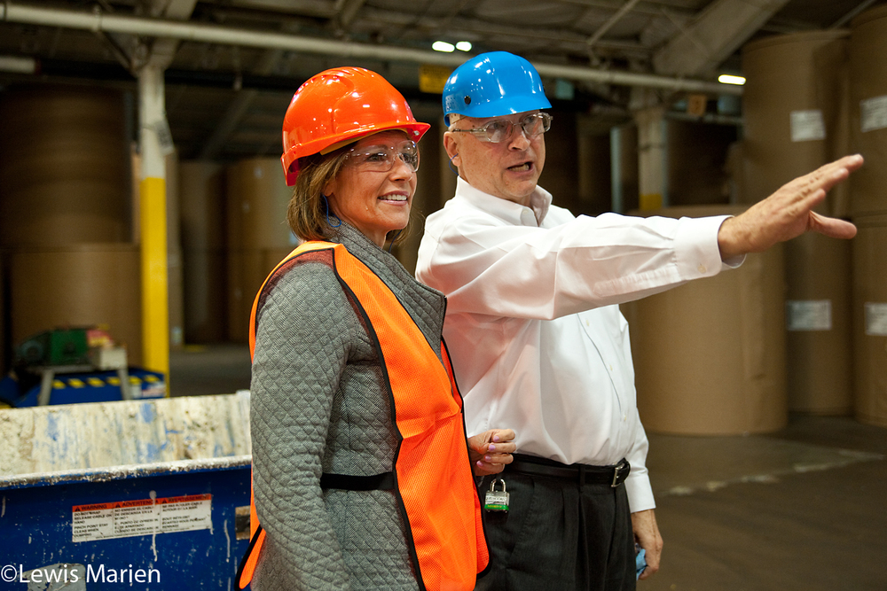 "Douglas Hooks, right, production manager at WestRock in Galesburg, points out areas of interest to U.S. Rep. Cheri Bustos, D-East Moline, while on a tour of the plant Oct. 5. Bustos toured WestRock as part of her ""Manufacturing Triangle Tour"" and to call for a long-term highway plan."