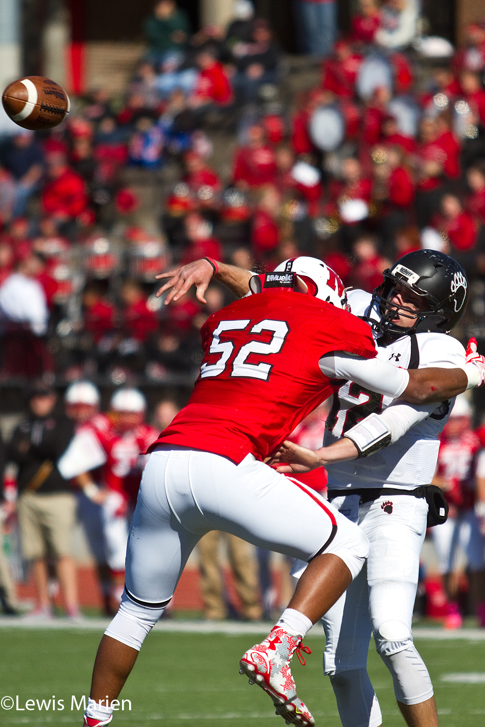 Lake Forest College quarterback Sean Dickson just gets off a pass as Monmouth College linebacker Michael Smith goes for a tackle on Oct. 17 at April Zorn Stadium in Monmouth, Ill. The Fighting Scots beat the Foresters 38-7.