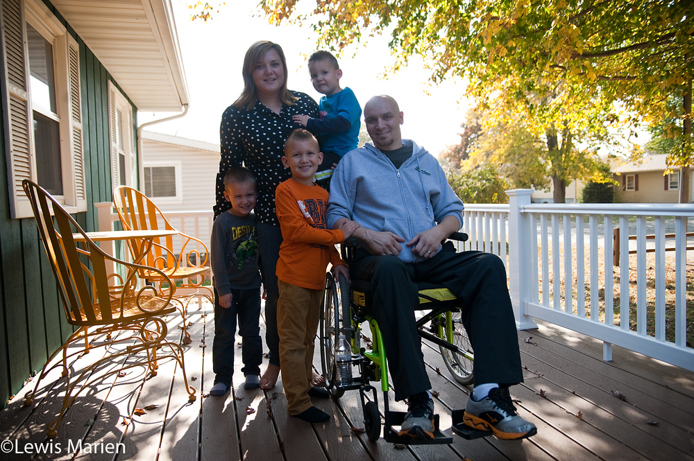 Jon Rekash, center right, of Abingdon, Ill., sits for a photo with his family on the porch of their house. On June 6, 2015, Jon, who had just became a full-time police officer with the Abingdon Police Department, went out one night to ride his motorcycle. Later that night, he woke up laying in a ditch and couldn't move. The accident has left him in a wheelchair but he says his faith in God and Jesus Christ has kept him alive, and the community of Abingdon has been supportive for him as he continues to recover.