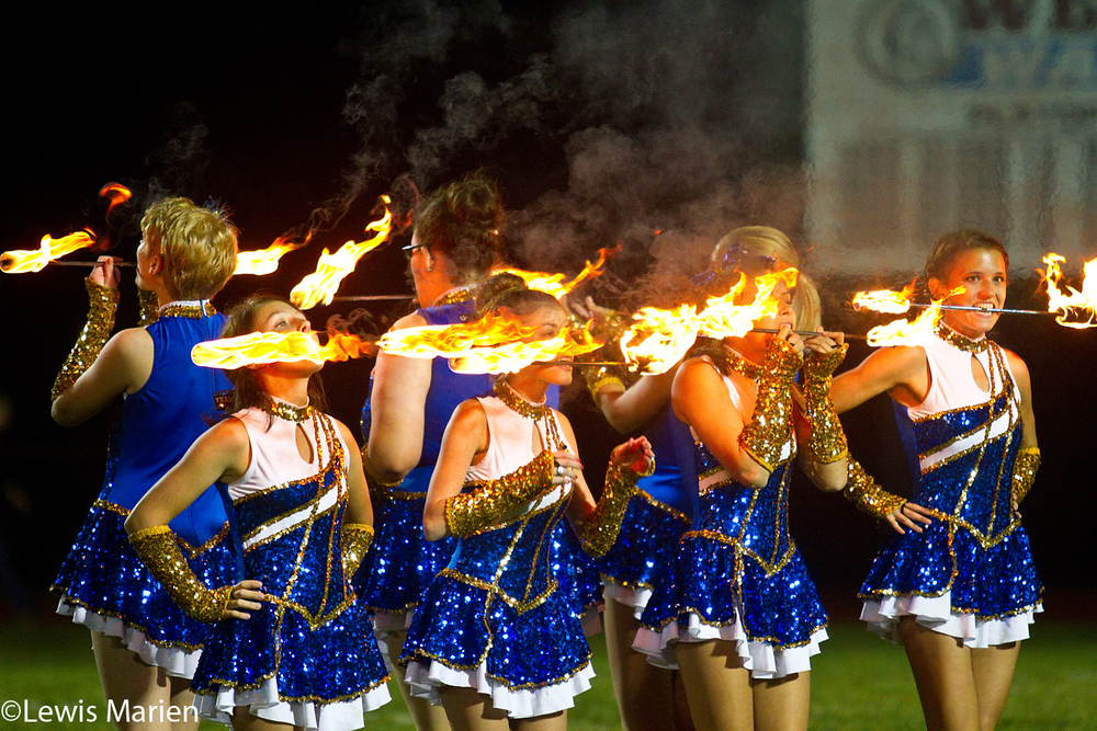 Spirit team members perform a fire trick during halftime of the Mercer County Golden Eagles-United Red Storm football game on Oct. 23 at George Pratt Memorial Field in Aledo, Ill.
