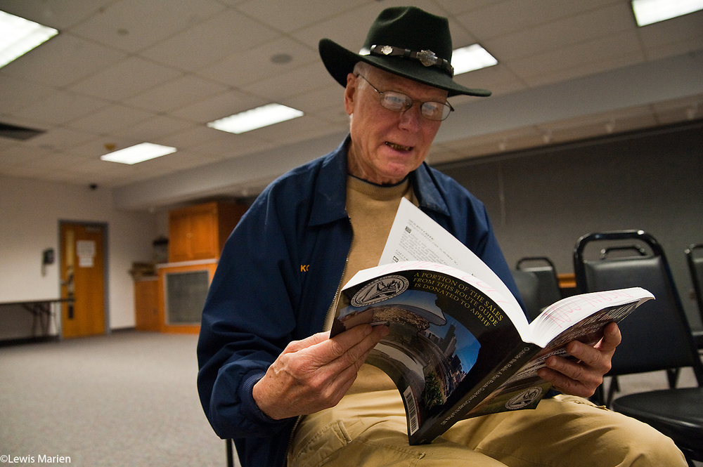 "K.C. Hill, of Galesburg, Ill., looks through a copy of ""Outside the Rails: A Rail Route Guide from Chicago to La Plata, Mo.,"" Nov. 7 at the Galesburg Public Library. The book, by authors Robert and Kandace Tabern of Wadsworth, Ill., explores in great detail the sights that passengers see out their train windows when passing through Illinois, Iowa, and Missouri aboard Amtrak's Southwest Chief train out of Chicago."