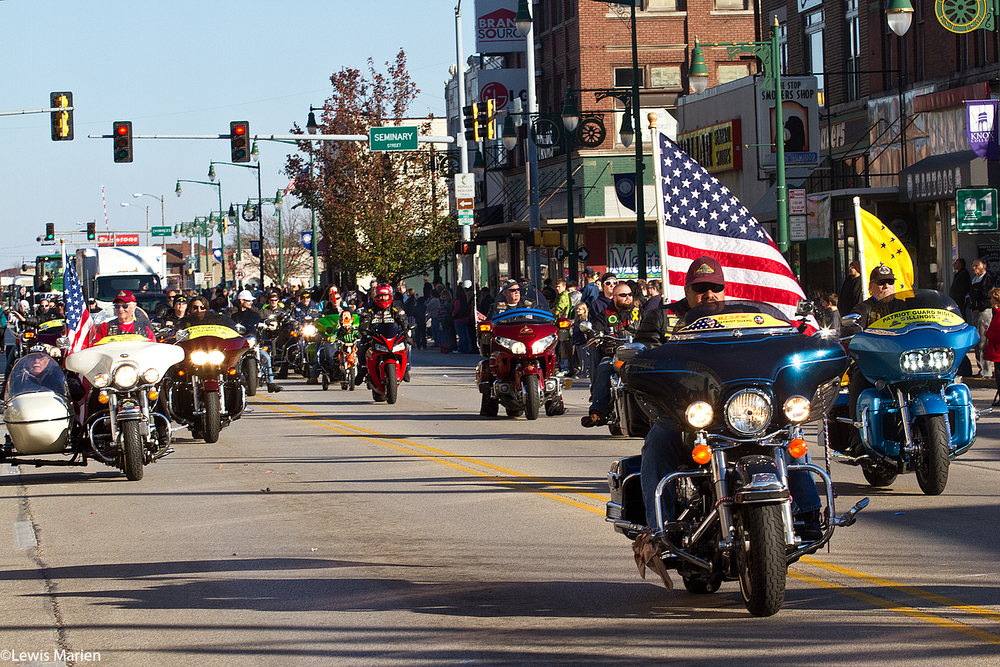 Members of the Illinois Patriot Guard ride down East Main Street in motorcycles during the 15th annual Veterans Parade Nov. 8 in downtown Galesburg, Ill.