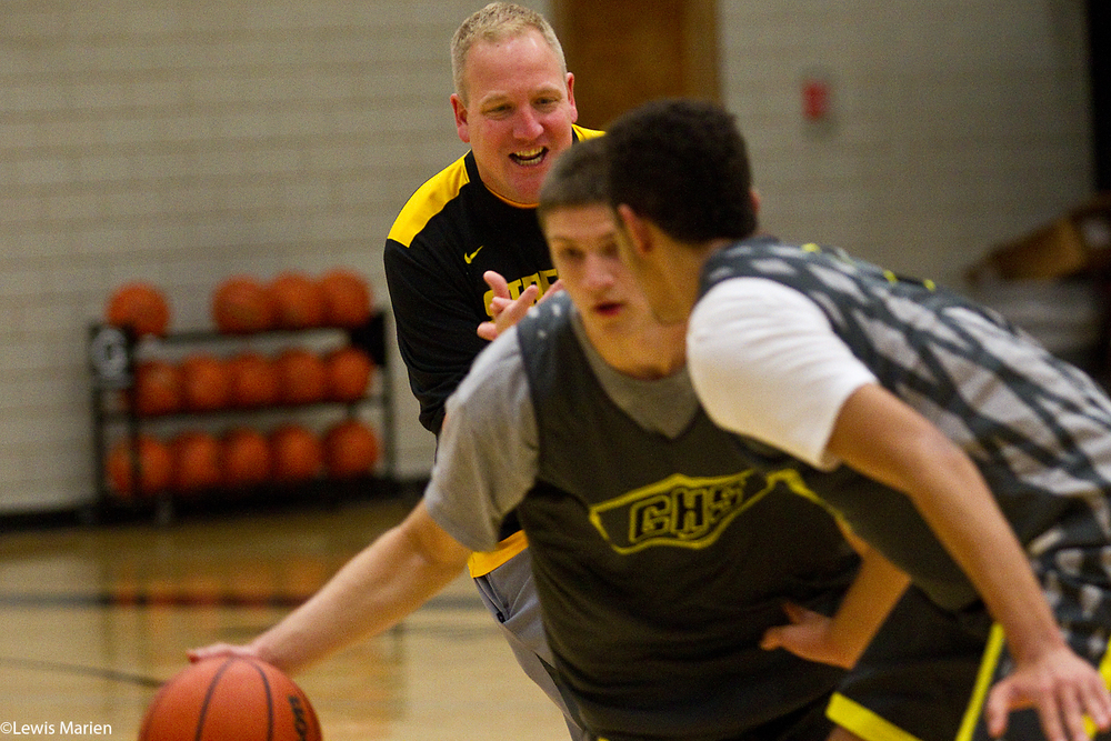 Galesburg High School boys basketball head coach Mike Reynolds watches as members of the team perform a drill during practice Nov. 9 at John Thiel Gymnasium.