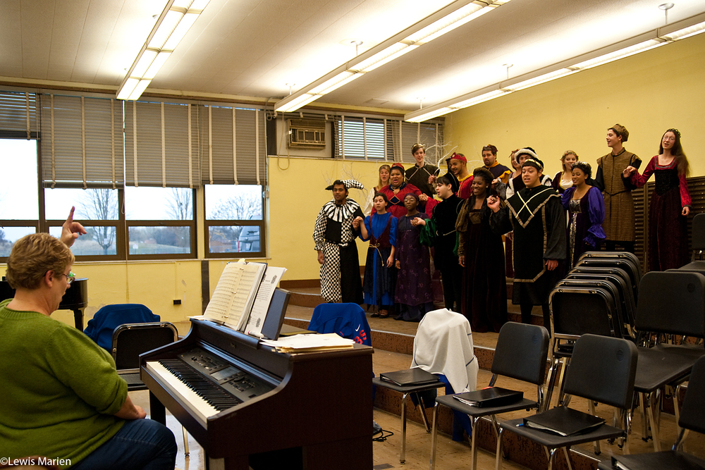 Paula Helle, left, leads members of the Galesburg High School choir in rehearsal Nov. 11. The choir has been rehearsing for its annual Madrigal Dinner held in December.