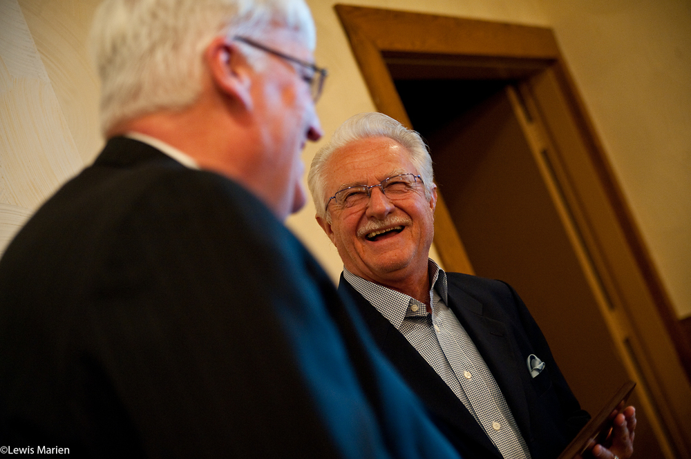 Dick Kowalski, of Galesburg, Ill., shares a laugh with mayor John Pritchard on Nov. 23 at the conclusion of the 37th annual Community Thanksgiving Luncheon at Best Western Plus Prairie Inn in Galesburg, Ill. Kowalski was named this year's recipient of the Thomas B. Herring Community Service Award, an award that recognizes a person who exemplifies true service to others without recognition or publicity.