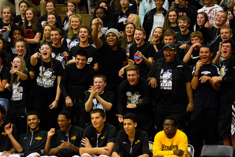 Galesburg High School's student section reacts to a play on the court during the Streaks' boys basketball opener against East Peoria on Nov. 25 at John Thiel Gymnasium.
