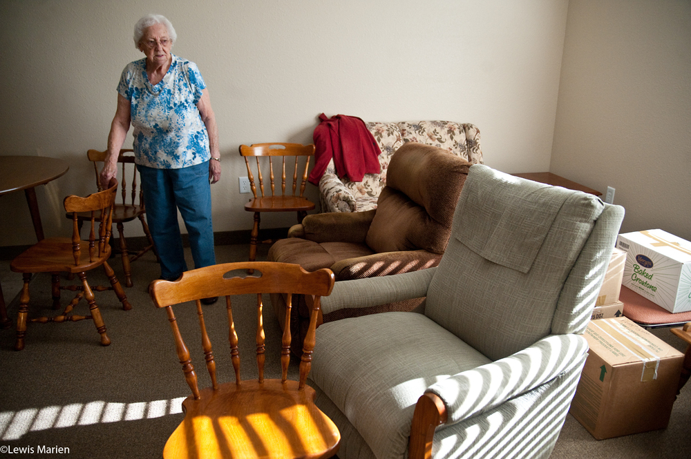 Shirley Warren, 91, of Canton, Ill., takes a look around her new living room at Courtyard Estates of Knoxville. Warren was one of the first residents to move into the new assisted living center Dec. 4, located on 415 E. Main St. in Knoxville, Ill.