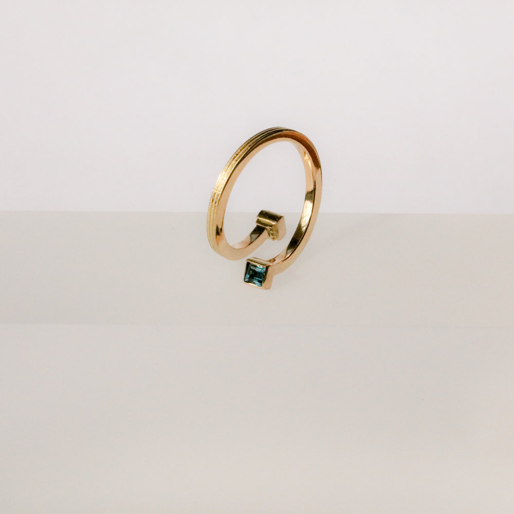 Helical Ring in 18ct yellow gold, set with dark green tourmaline