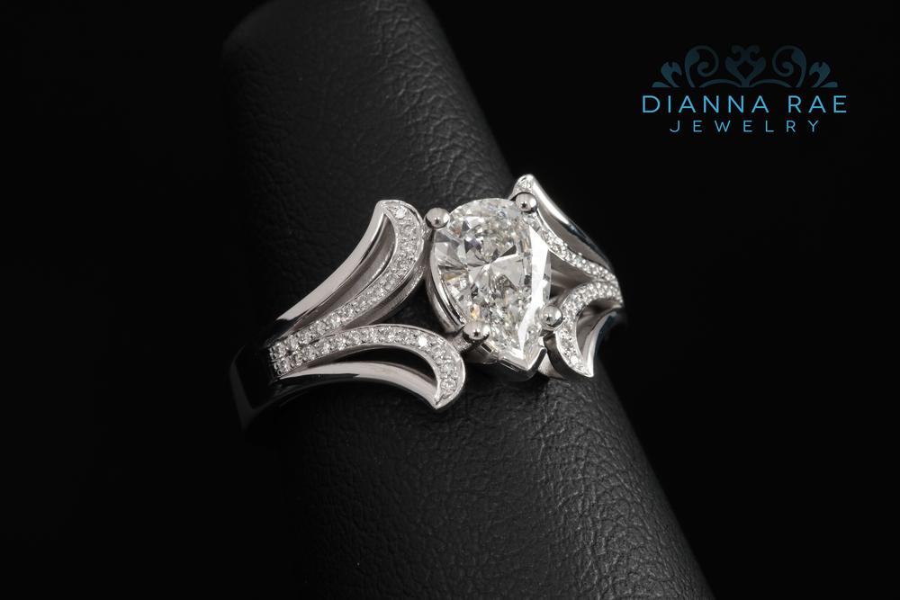 001-01597-001_pear diamond eng ring.jpg